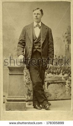 USA - ILLINOIS - CIRCA 1870 A vintage Cartes de visite photo of a man standing. He is dressed in a vest, suit coat and bow tie. Photo is from the Victorian era. CIRCA 1870