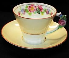 PARAGON QUEEN ELIZABETH KING GEORGE FLOWER HANDLE TEA CUP AND SAUCER