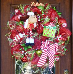 This 27 MERRY CHRISTMAS MOOSE Wreath is adorable with its cute moose! It also features a HO HO HO sign, Christmas balls, a red and white striped bow,