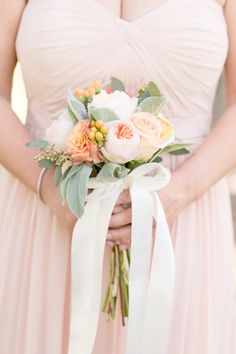 Blush bridesmaid dress and peach bouquet: http://www.stylemepretty.com/little-black-book-blog/2014/09/18/boho-chic-travel-themed-orlando-wedding/ | Photography: Amalie Orrange - http://amalieorrangephotography.com/