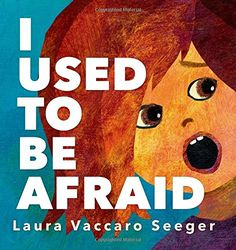 """10.7.2015. I Used to Be Afraid by Laura Vaccaro Seeger (September 2015).  I always do an """"I'm Not Scared"""" storytime in October, and this book is perfect. With simple text and those wonderful die-cuts that Seeger always uses, kids can explore why you might be afraid of something before you learn more about it. The ending shows her getting back at her brother for using a scary mask, which ties in well with the season without focusing on Halloween."""