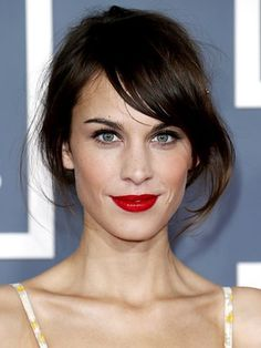 Updo Hairstyles: Alexa Chung's short hair, low, looped bun with side-swept bangs | allure.com