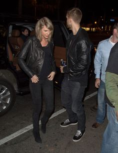 The couple that gets dressed together, stays together? Judging by Taylor and Calvin's coordinating black leather jackets and dark denim, it would appear so.