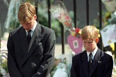 Princes William and Harry, sons of Diana, bow their heads as their mother's coffin is taken out of Westminster Abbey. (Adam Butler/WPA Rota/The Canadian Press)