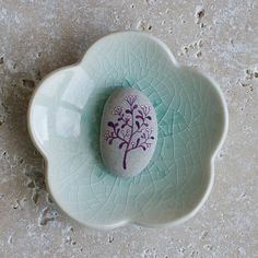 A one of a kind Hand-painted pebbles by me (Afsaneh Tajvidi) Ive found these smooth pebbles on the beaches of Lake Ontario, Canada. To paint on the pebbles I used acrylic colors, a very tiny brush, micron pen and lots of love! The design is sealed after painting. This listing is for the set of two painted pebbles. Size: Each is approximately 2.7cm x 1.8cm x 0.8 cm The last photo gives you an idea on how to frame the pebbles. Ive glues them in shadow boxes using E6000 glue. Small shadow bo...