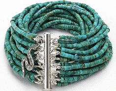 Freaking Amazing!     Turquoise Multi-Strand Beaded Heishi Bracelet / Tube Beaded Cuff / Sterling Clasp with Vintage Sterling Snake Charm. $350.00, via Etsy.