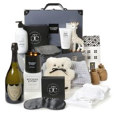 Welcome a newborn baby to the lap of luxury with this seriously impressive baby gift hamper. When you need to shower a baby with love and generosity, this is a superb choice. Baby Gift Hampers, Baby Hamper, New Mommy Gifts, Baby Gifts, Luxury Hampers, Dom Perignon, Baby Checklist, Photo Shoot, Baskets