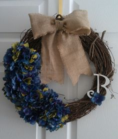 Grape vine wreath decorated with hydrangeas, burlap strip for a bow and personalized letter! Super easy and cute!