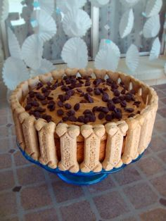 Hmmm.. I could see myself making this for Ace.  Carob chips are completely safe for dogs, but I probably wouldn't use them. I would also use a different dog treat for decoration. Doggy Birthday Cake! :)