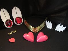 Super Sailor Chibi Moon cosplay accessory set!    Includes:  - Tiara (crescent moon version)  - 2 Heart Brooches (opaque pink - for bow and