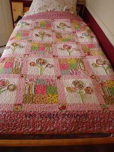 Love the appliqued flowers quilt