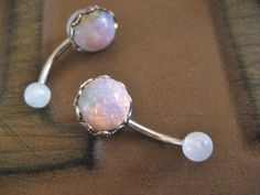 Lovely faux glass fire opal on an acrylic and surgical steel barbell. This is a lighter version of my original pink fire opal belly ring. Each glass opal is different! See my shop for more more unique