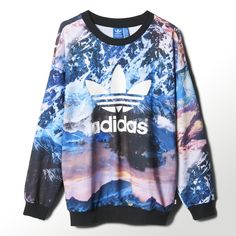 Enjoy the view of a scenic mountain vista. An allover photo print makes a graphic statement on this women's sweater.
