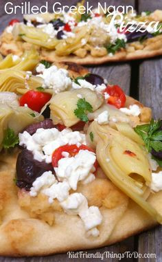 Grilled Greek Naan Pizzas Recipe - These are the most amazingly simple pizzas. Perfect for holiday appetizers, summer BBQs, or a family dinner at home!