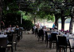 Dining terrace of Hotel Dassia Beach Restaurant on Dassia Beach, Corfu.