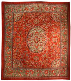 An early 20th century Savonnerie antique carpet, the tomato-red field with an…