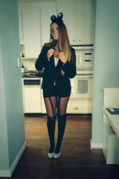 Halloween. Fashion. Cat. Garter tights. Suspended looks. Christian Louboutin.