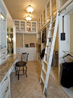 Evolution of Style: Mastering the Master Closet  Love the ladder for upper storage, beautiful space walk in closet dressing room