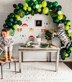 "A super cute ""FOURever Wild"" safari themed party for a little boy featuring adorable animal themed party supplies. Check out our ""Get Wild"" collection for more party decoration ideas! Toddler Birthday Themes, 3 Year Old Birthday Party Boy, Party Themes For Boys, Birthday Ideas, Baby Birthday, Safari Theme Party, Safari Birthday Party, Balloon Arrangements, Party Goods"