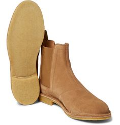 These Bottega Veneta Chelsea boots have been masterfully crafted in Italy from plush camel suede, typifying the uncompromising standards of the brand. They're lined in spongy leather and set on crepe soles to ensure comfort. Try yours with selvedge denim and knitwear when dashing about town.