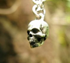 This skull pendant is made of full sterling silver. Realistic design yet really stylish made from pure sterling silver.  The silver pendant is oxidized to deepen every detail and enhance the appearance of depth in the design, which gives the feeling of goth and vintage. Our Website: http://hongxistudio.com/