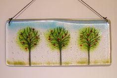 Image from https://waciglass.files.wordpress.com/2012/12/3-round-trees-fused-glass-hanger.jpg.