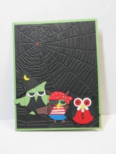 Halloween card...embossing folder spiderweb....three adorable owl treak-or-treaters...