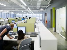 white work stations, concrete floors, Belkin office