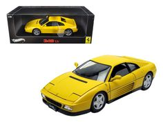 Hot wheels 1989 Ferrari 348 TB Yellow Elite Edition 1/18 Diecast Car Model by Hotwheels - Brand new 1:18 scale diecast model car of 1989 Ferrari 348 TB Yellow Elite Edition die cast car model by Hotwheels. Limited Edition 1 of 5000 Produced Worldwide. The Ferrari 348 TB made its debut at the 1989 Frankfurt Auto Show. With its high standard of build quality along with exceptional performance, the 2-seat sports car quickly became very popular. Like most of the Ferrari models, the body was…