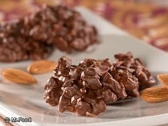 Chocolate Almond Clusters - These two-ingredient chocolate candies are great to keep out during Christmas for your guests!