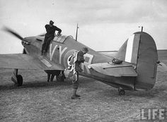Hawker Hurricane RAF ace Albert G. Lewis adjusting his parachute before take-off during the Battle of Britain.