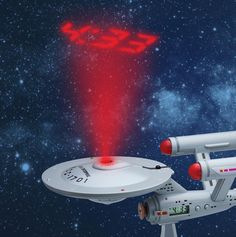 Wake up and boldly go! Alarm clock projects the time onto the wall or ceiling. Looks like the USS Enterprise Starship. Uss Enterprise Ncc 1701, Star Trek Enterprise, Star Trek 50th Anniversary, Projection Alarm Clock, Original Tv Series, Geek Gadgets, Geek Stuff, Stars, The Originals