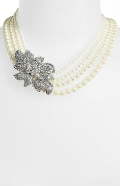 Multistrand pearl necklace with vintage glam crystals.