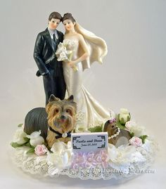 Customized dogs with bride and groom wedding cake topper. Shown with Yorkshire terriers in ivory with pink accents. Personalized hair color changes. Includes name and wedding date plate.  http://www.affectionately-yours.com/yours-mine-and-ours-wedding-cake-topper/