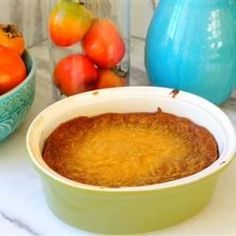 A simple baked persimmon pudding with just a hint of cinnamon. This recipe was found in my grandma's recipe box. I made it for Thanksgiving and it was a huge hit!