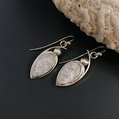 Matched pair of white Crazy Lace agate stones set with fine and Sterling silver in a contemporary design. Ball detail is solid sterling silver and ear wires are hand forged from sterling wire.Measures 1 3/4 from top of the Sterling silver ear wire...
