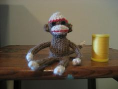 Tiny Sock Monkey - This pattern is available as a free Ravelry download This just uses scrap yarn and small DPs--the smaller the yarn and needles, the tinier the monkey. There are also directions for a tiny owl, but I didn't have a picture of him.