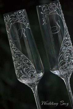 Item details: Pair of luxury champagne flutes for your wedding reception. An original design of embossed lace - hand decorated with professional paints and Swarovski Element Stones. Toast to the bride and groom with this gorgeous set of personalized champagne flutes Dimensions: h= 265mm