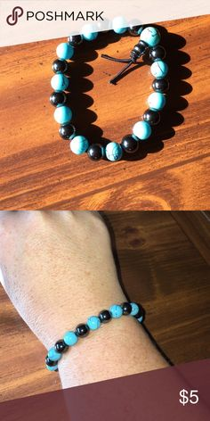 Turquoise and grey bead stretch bracelet In excellent condition - turquoise and grey/black bead stretch bracelet. Jewelry Bracelets