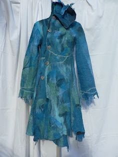 felting onto cloth or existing clothing piece (in this example, the person was putting together a coat with fabric, and felted onto the cut pieces of fabric, before sewing.)