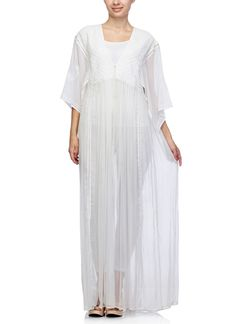 Whites are so in vogue this season and Satya Suman presents to you the classiest gown in white. This beauty is made in flowy crushed cotton, adorned with traditional chikankari embroidery. The pleats on the bodice and the wide sleeves add a bohemian twist to the ensemble. Wear it over a matching tank top and tights for a day when you want to exude the 'casual slouchy' look.