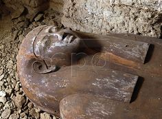 A limestone sarcophagus of a unidentified person, discovered during excavation at the Mastaba of Akhethetep to the north of Unas Causeway in Saqqara., 22 December 2003. The French archaeological mission of the Lourve Museum has unearthed three burial shafts leading to several intact tombs yesterday.