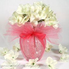 Simple and pretty center pieces.  Vases filled with crystal gel and wrapped with tule and a ribbon.