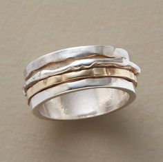Two bands spin on a single ring, sterling silver representing pros, 14kt gold symbolizing cons. A handmade exclusive. Whole sizes 5 to 9.