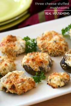 THREE CHEESE STUFFED MUSHROOMS are a party perfect appetizer made by stuffing mushrooms to the brim with three kinds of cheese and topping them with buttery panko breadcrumbs!