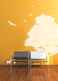 tree of life decal on a sunny yellow wall