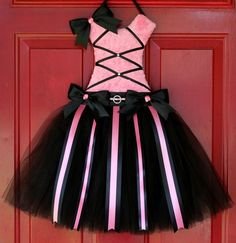 Hot Pink Minky Ballerina The Bodice is made with a Hot Pink Minky Dot Fabric The Skirt is done in Black Tulle.  The ribbons are in Black and