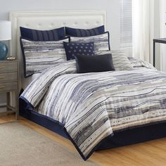 Refresh your master suite or guest room with this lovely comforter set, showcasing neutral-hued striping for stylish appeal.  Produc...
