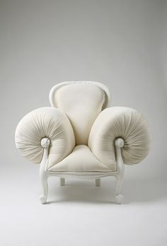 I don't know how exactly one sits in this, but it is rather intriguing.  I shall call it, my French Poufe Chair.