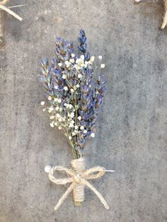 Grosso lavender corsage with Baby's Breath wrapped in twine - but fresh of course!